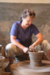Image of lady taking a pottery lesson. Photo used in abstract photo montage